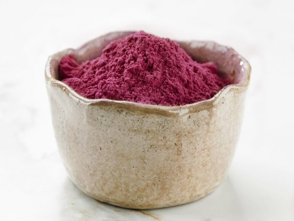 bowl of beet root powder on kitchen table
