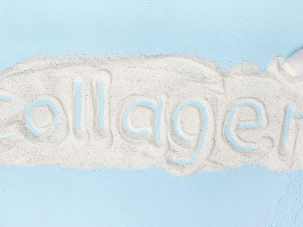 blue background with collagen powder close up